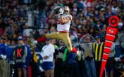 george kittle leaping